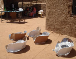 Women spend less time and energy foraging for firewood outside of IDP camps when they use solar CooKits (photo DPDO)