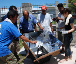 Workshop participants in Kiribati cook rice in a solar box cooker (photo: Ferris University)