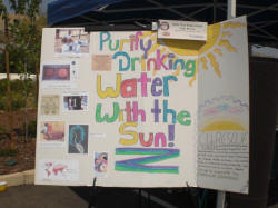 Club RESC:UE members give solar cooking and solar water pasteurization presentations at local events and schools (photo: Club RESC:UE)