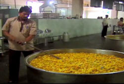 Temple chefs must use huge cooking vessels to meet the daily demand for food (photo: CNN)