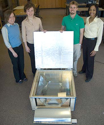 From left to right, Anna Young, Lori Hanna, Dan Hensel and Lauren Dokes with their solar autoclave