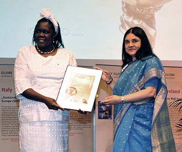 SCI Eastern Africa Director Margaret Owino (left) accepts the Energy Globe award from Maneka Gandhi, chairperson of the international jury