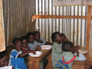 Hamomi Children�s Centre students enjoy a solar meal in their classroom