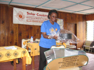 SCI�s eastern Africa Field Assistant Faustine Odaba explains how to prepare a pot of food for solar cooking