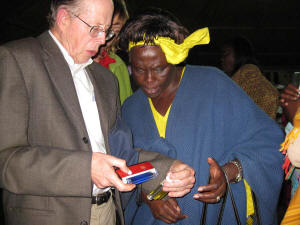 Dr. Metcalf explains Colilert� water test results to Wangari Maathai