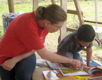 Dr. Margaret Pinnell reads with a child