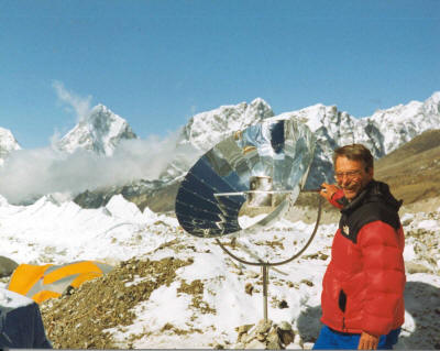 Allart Ligtenberg boils water on Mount Everest using a collapsible parabolic cooker he developed for use by trekking groups