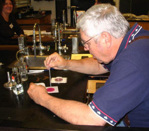 Bill Camp learns to test water quality using a Petrifilm� test