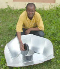 Rashid Adesiyan pasteurizes water in a solar CooKit in Ago-Are
