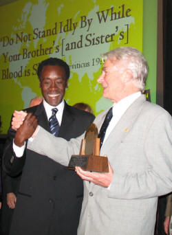 Derk Rijks (right) is congratulated by Don Cheadle.