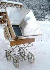A baby carriage keeps the SunStar out of the snow and angled towards the sun
