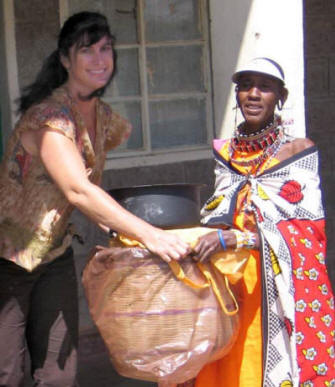 Karyn Ellis (left) helped distribute solar cookers, pots, and �hay baskets� in Kajiado as part of a training program funded by SCI and the Lift Up Africa organization