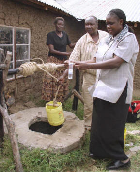 Margaret (right) conducts water quality tests in Nyakach, Kenya