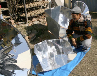 Sanu Kaji Shrestha and FoST promote several types of solar cookers, as well as fuel-efficient stoves that burn special briquettes made from agricultural and industrial waste