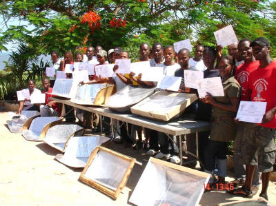 Maputo youth show off their solar cookers and the certificates they earned for completing the training course