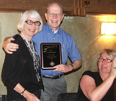 Barbara Knudson (left) receives award from SCI founder and board member Dr. Bob Metcalf