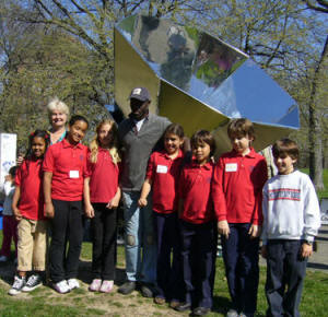 Rowena Gerber (back row, left) and her students pose with the large Villager Sun Oven�