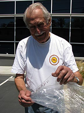 Volunteer Don Coan tests solar cooking bags for durability: 34 uses!