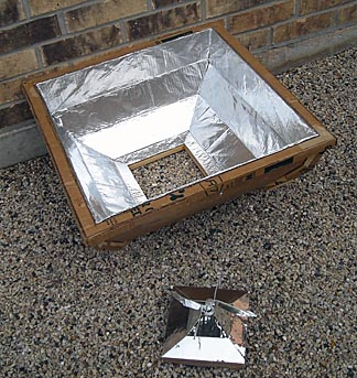 Goodman's solar cooker can be built in two pieces: a weighted middle section that holds the HotPot and the four-sided reflector that surrounds it