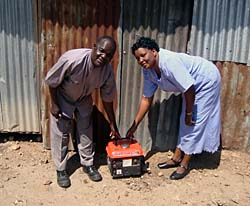 With VSL loans, SCOREP Leonida Bodo purchased a generator to help her chicken business expand (Photo: SCI)
