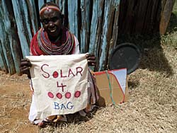 Simple solar cooker kits, stocked with CooKits from Solar Cookers International, are providing hot, sanitary water for Traditional Birth Attendants in Kenya (Photo: SHEP)